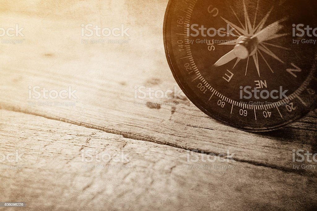 compass on wooden table in vintage style for background stock photo