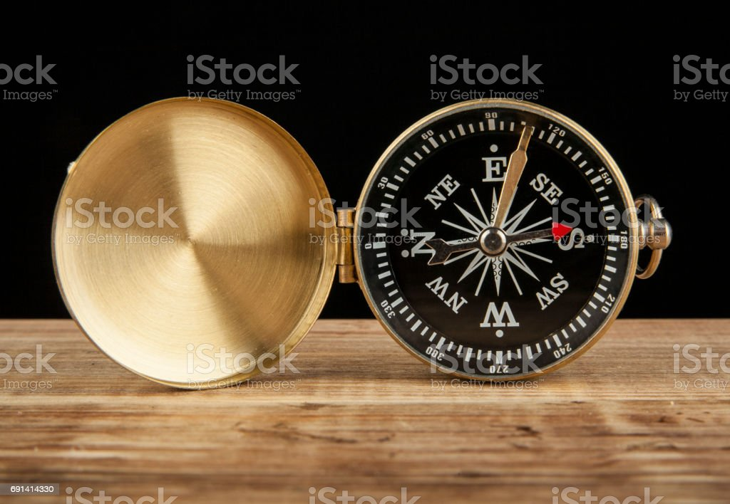 compass on wooden table with space for text stock photo