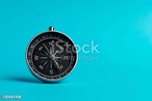 Compass on the blue background.