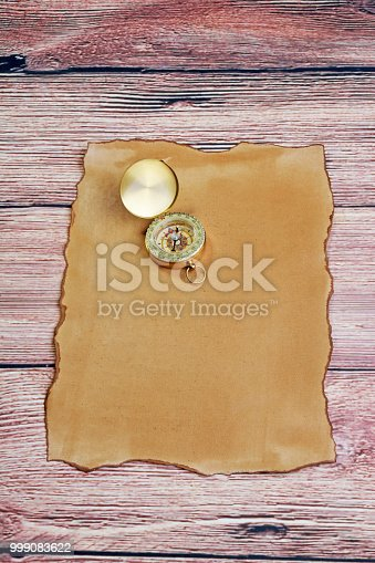 compass on parchment paper