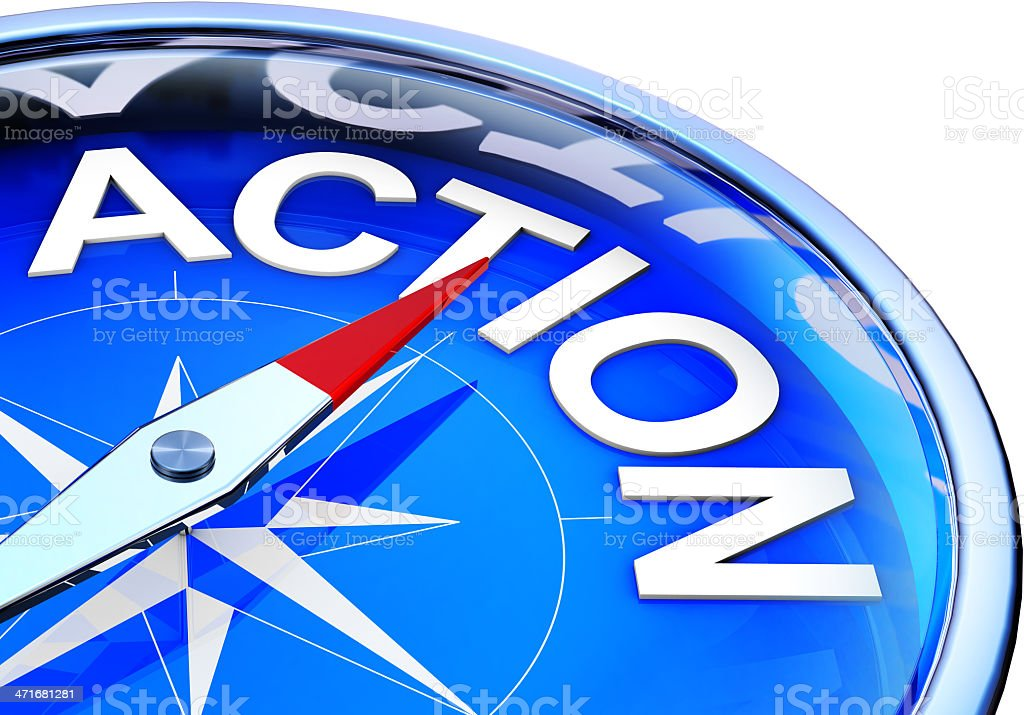 A compass pointing towards the word action royalty-free stock photo
