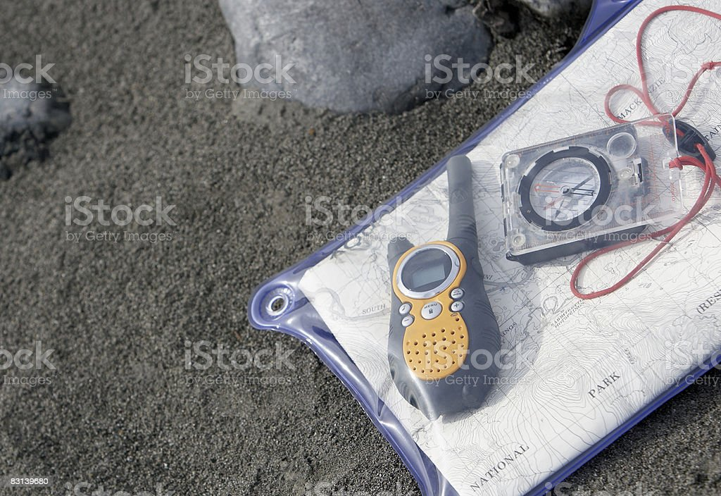 compass, walkie-talkie, and map on beach  foto de stock libre de derechos