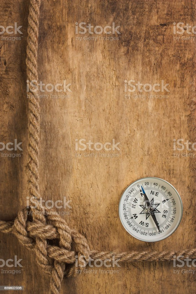 Compass with a rope stock photo