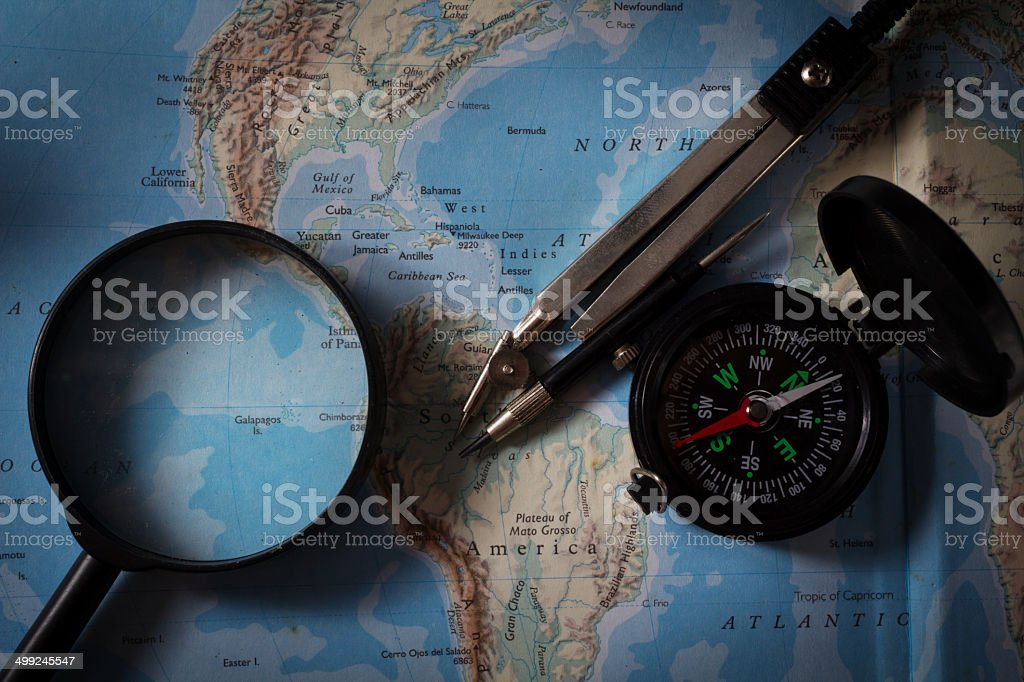 Compass with map and magnifier ,navigation equipment. royalty-free stock photo