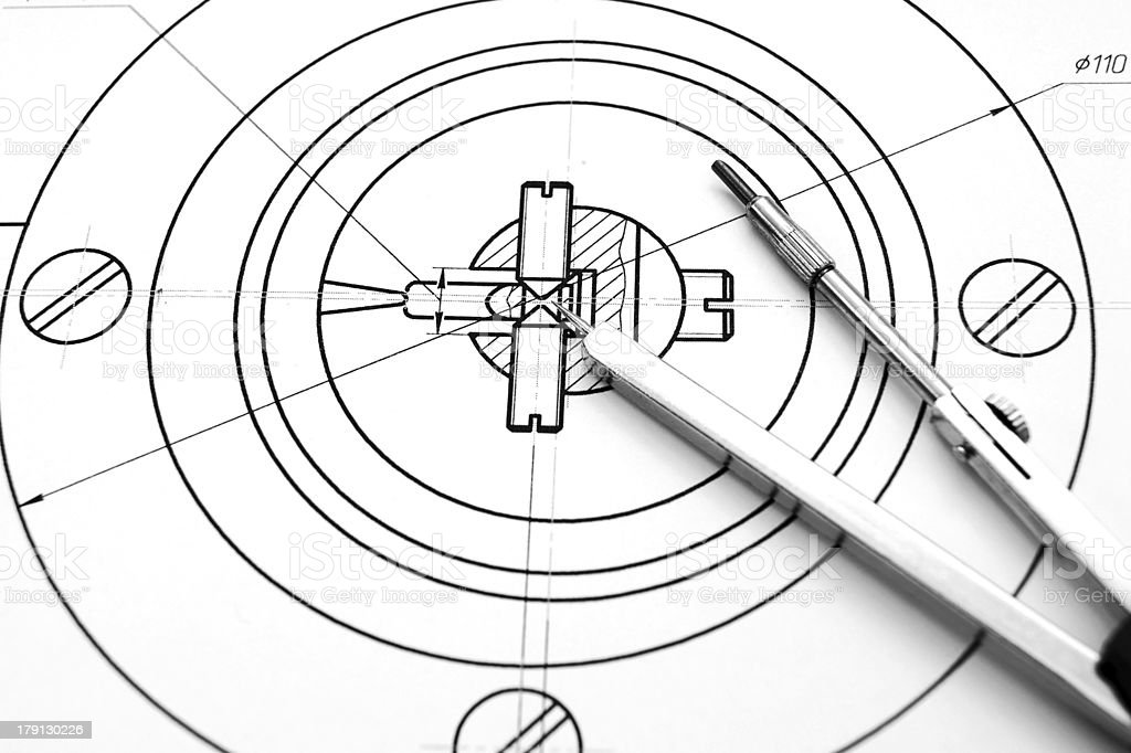 Compasses and the drawing. royalty-free stock photo