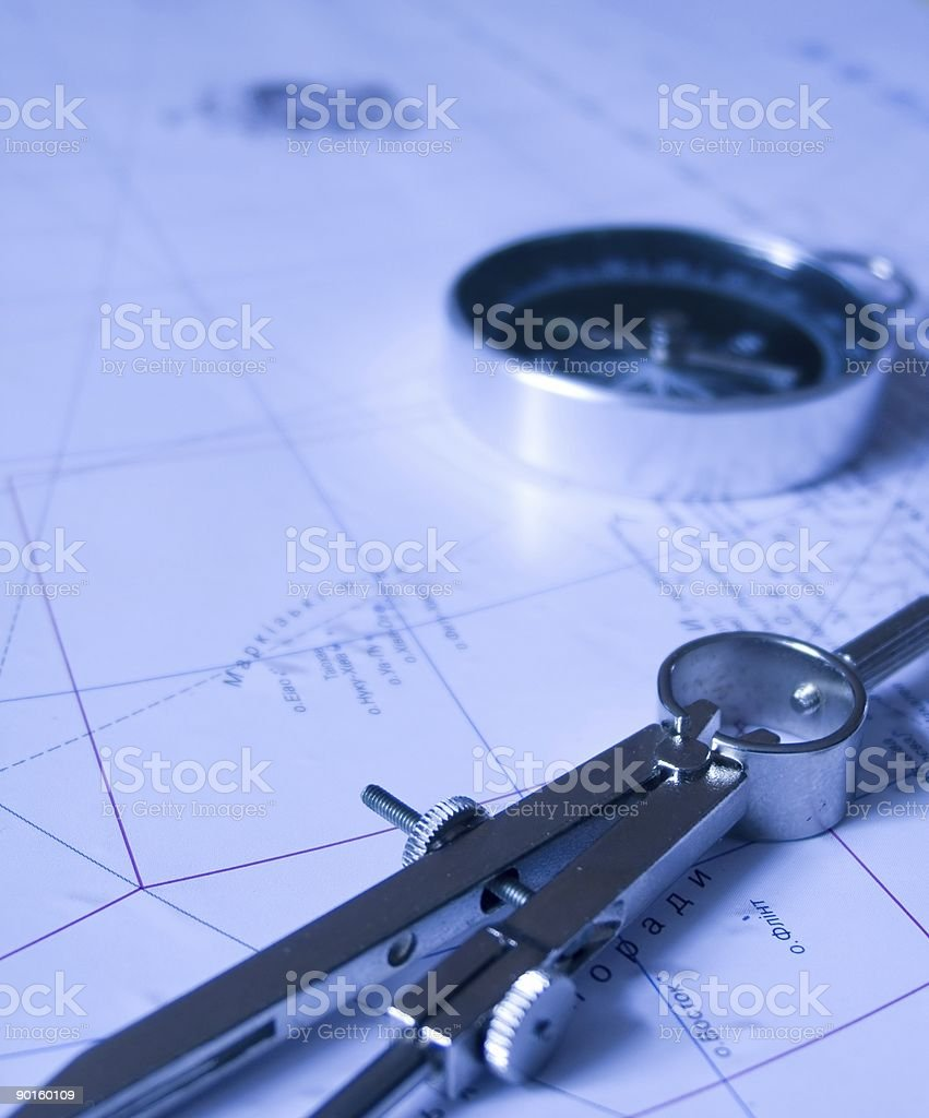 Compasses on the map royalty-free stock photo