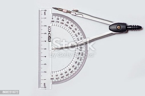 1060723604istockphoto Compasses Protractor isolation 868231672