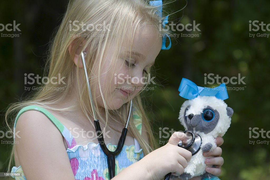 Compassion - Pretty Girl Playing Doctor With Teddy Bear royalty-free stock photo