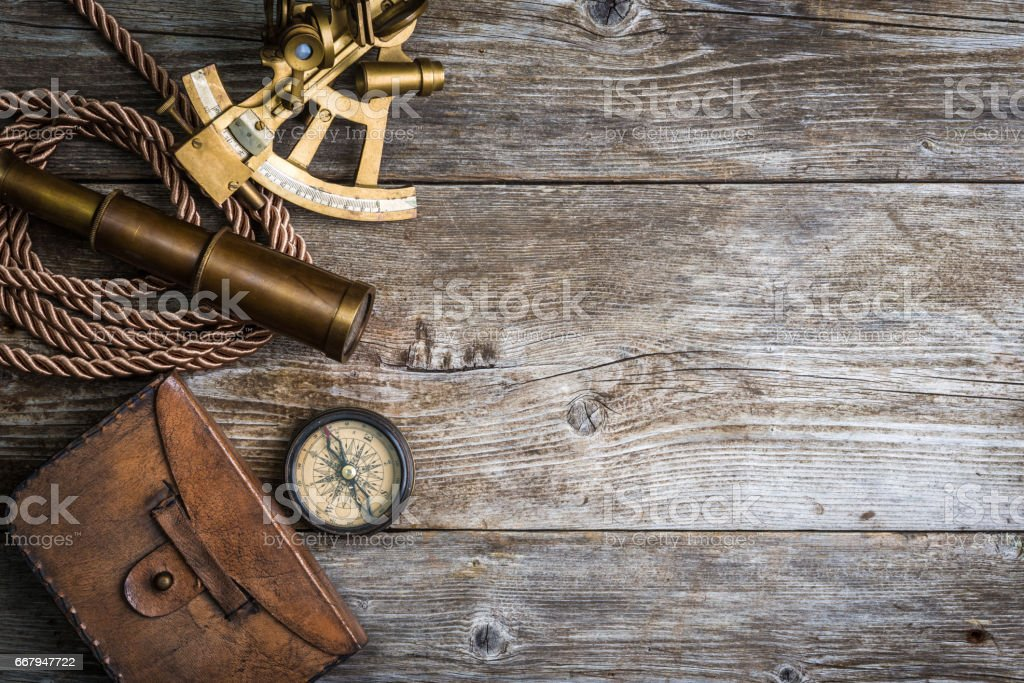 compass,sextant and spyglass on the timber stock photo