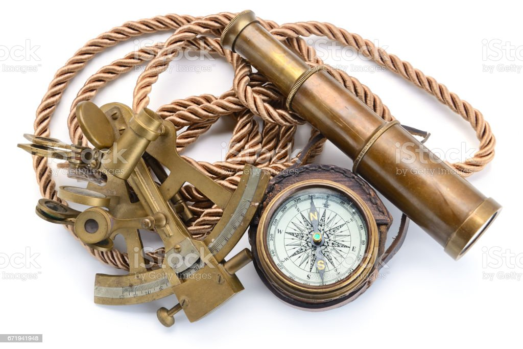 compass,sextant and spyglass on the white stock photo