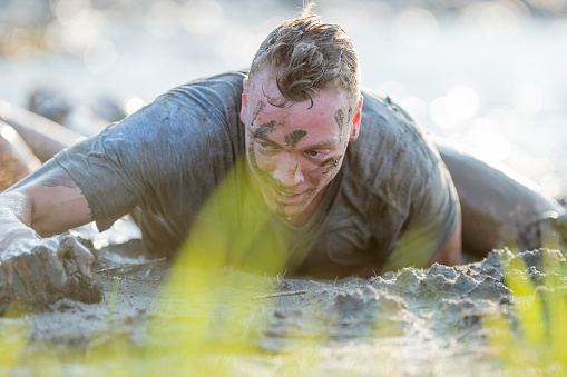 687723318 istock photo Competing in a Mud Run 687722920