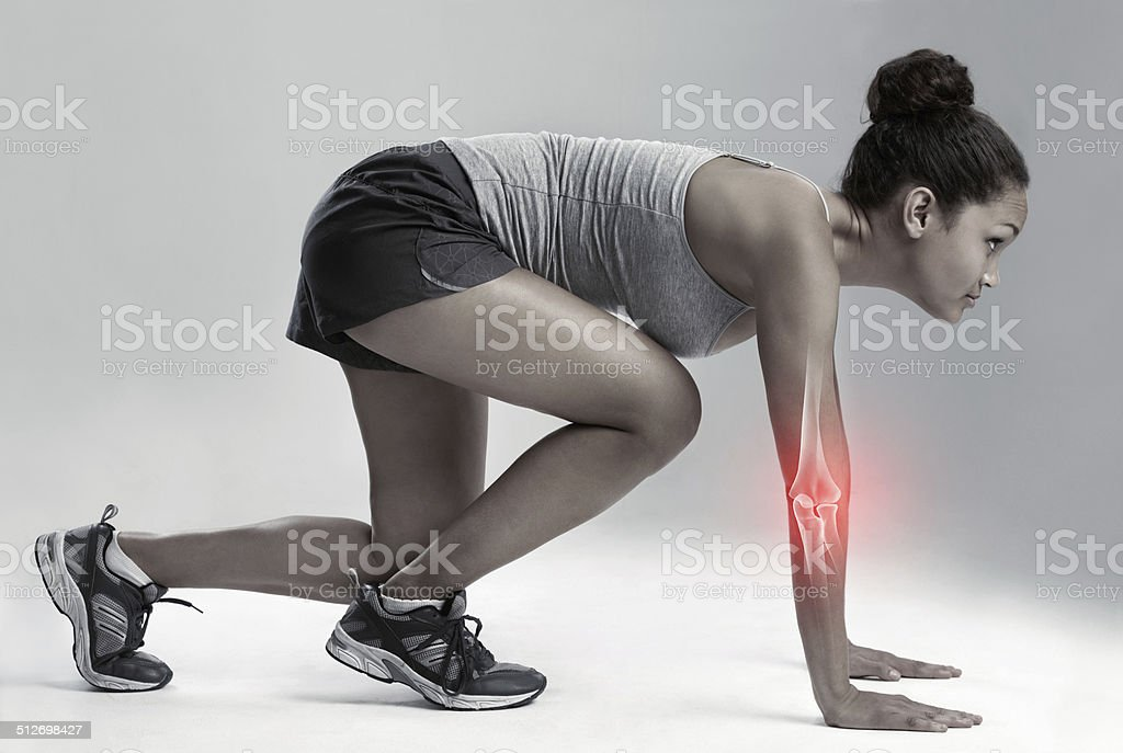 Competing through the pain stock photo