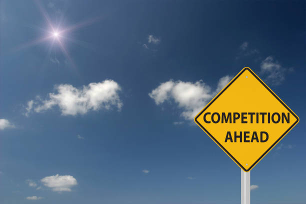 Competition ahead warning sign concept stock photo