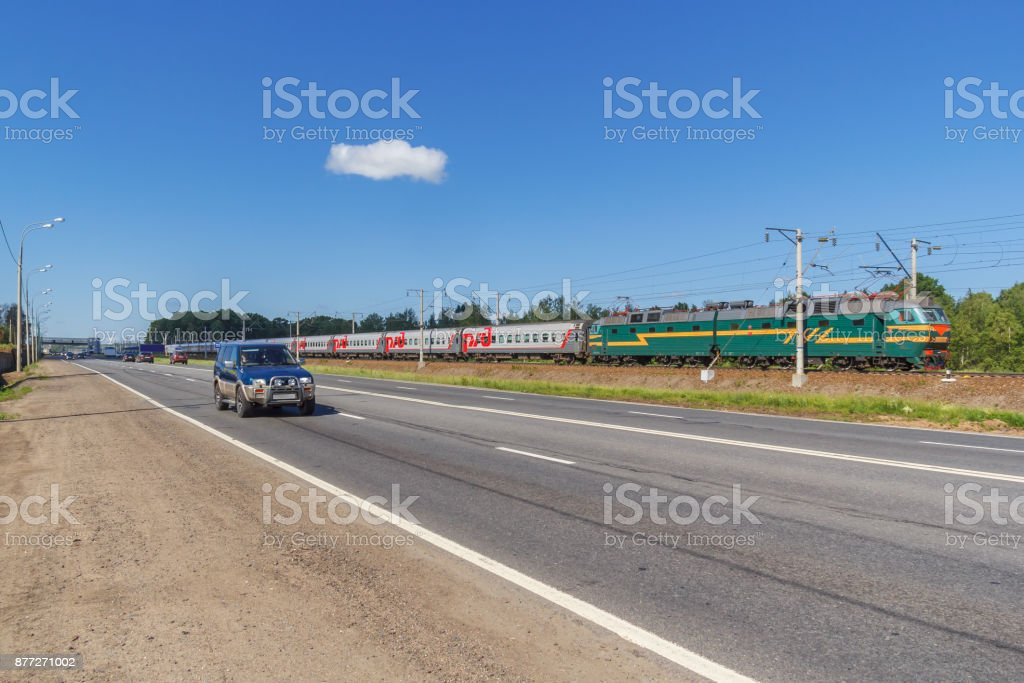 Competition between the car and the train stock photo