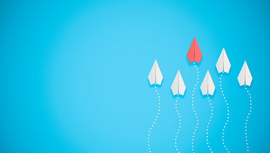 istock competition concept with paper planes on blue background 1150377904