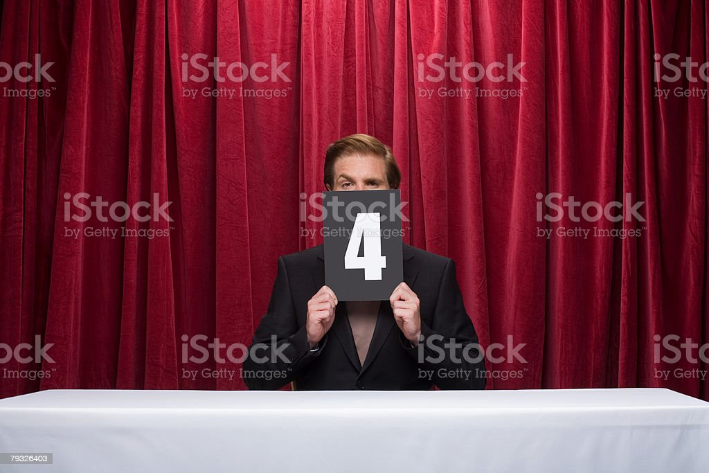 Competition judge holding a score card royalty-free 스톡 사진
