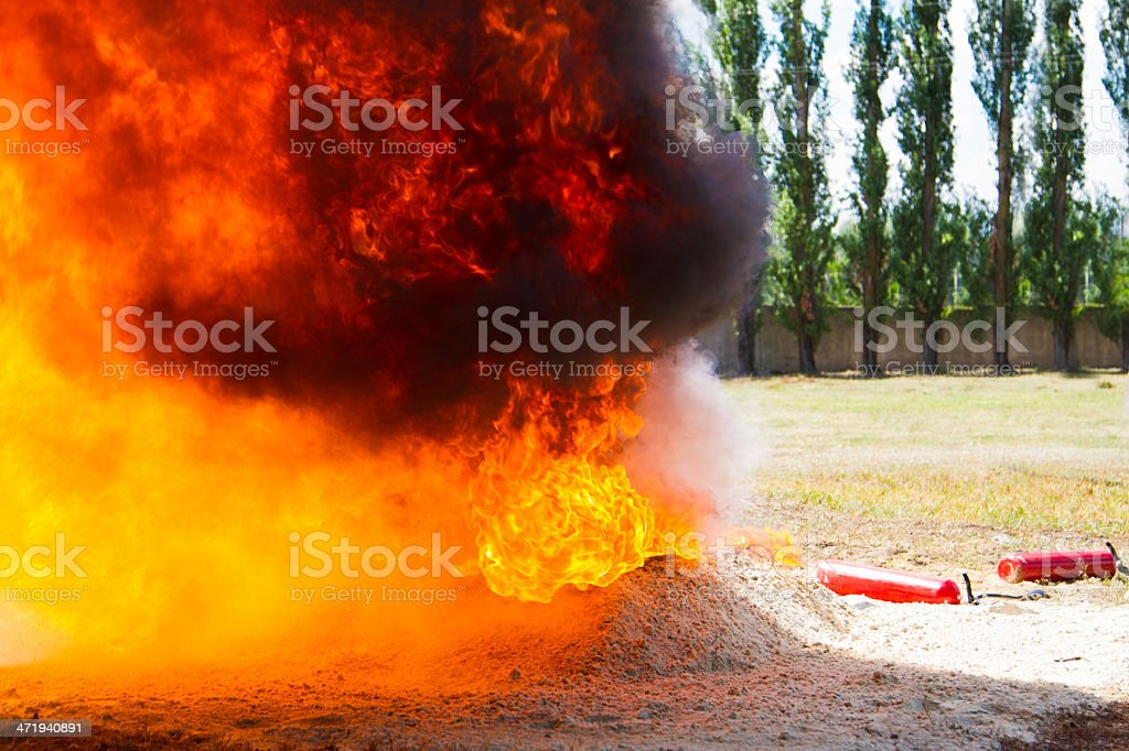 Competition rescuers. Ground to extinguish flames stock photo