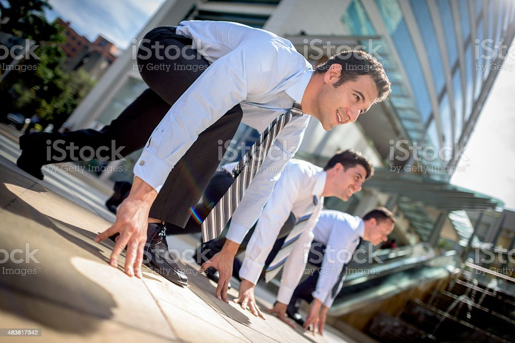 Competitive business men racing stock photo