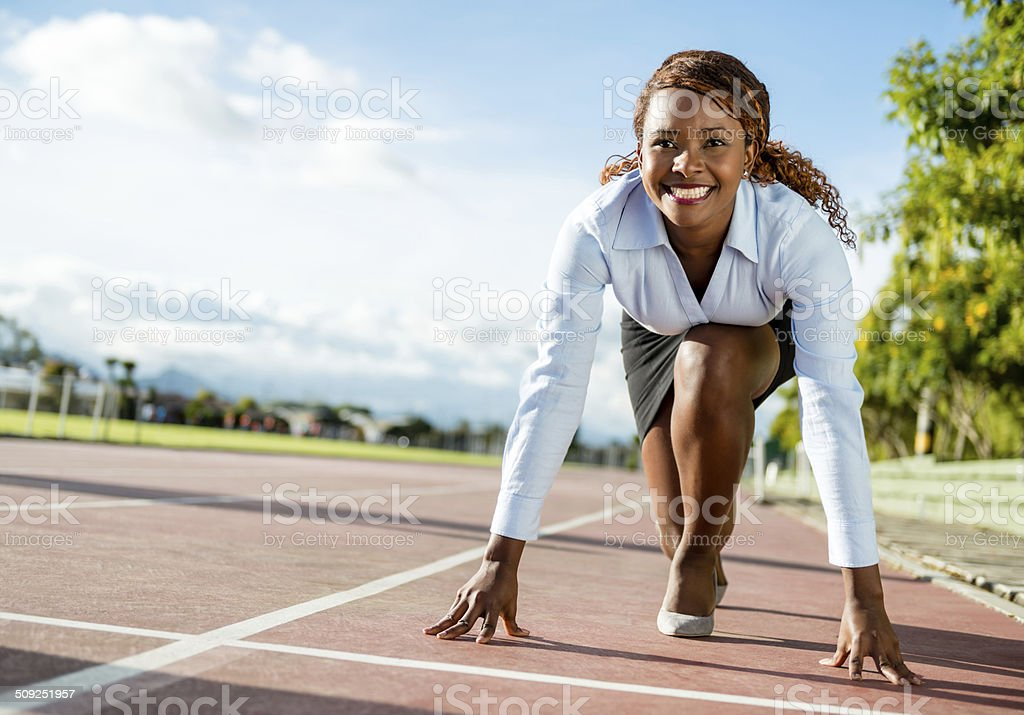 Competitive business woman stock photo