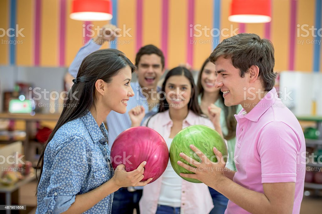 Competitive friends bowling stock photo