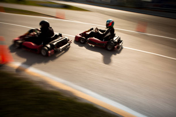 Competitive go-cart racing blurred stock photo