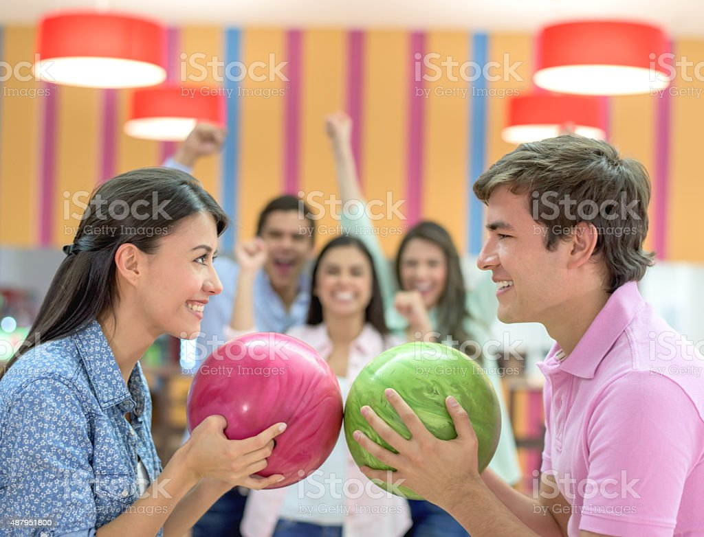 Competitive man and woman bowling stock photo