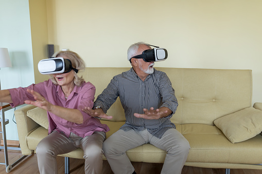 istock Competitive Senior Couple Playing 3D Games 1254251022