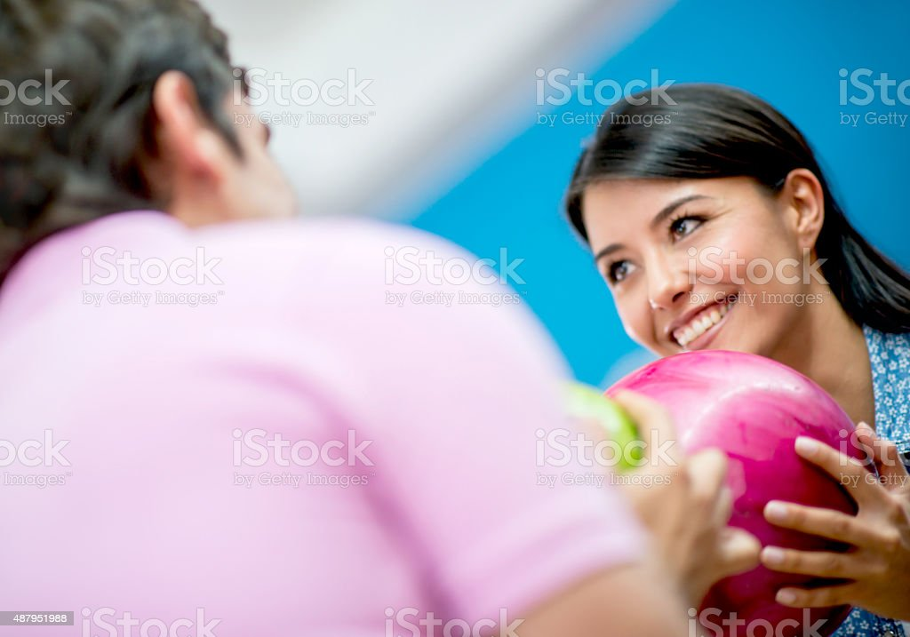 Competitive woman bowling stock photo