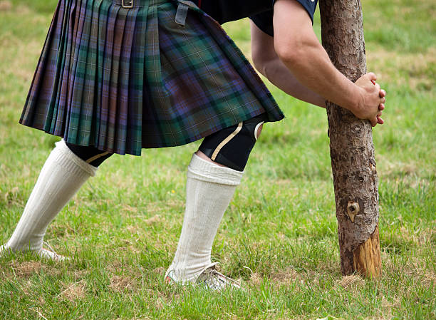 Competitor about to lift a caber stock photo