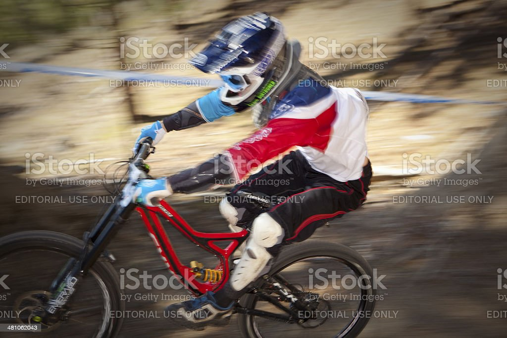 Competitor at speed during a downhill race. royalty-free stock photo