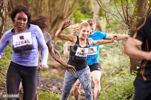 986840244 istock photo Competitors running in a forest at an endurance event 481448480