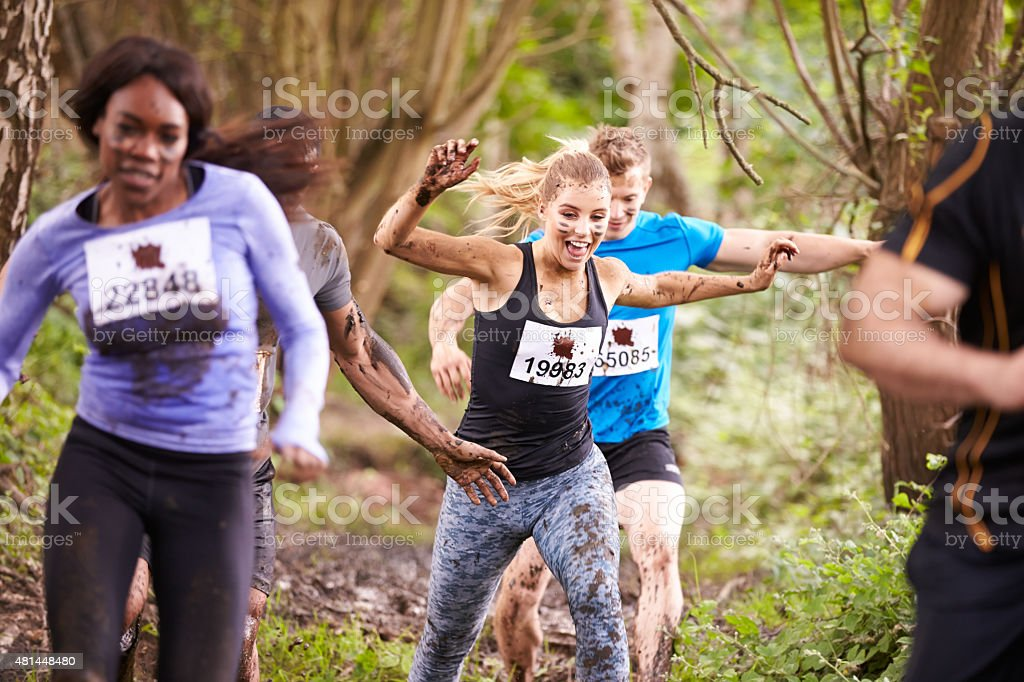 Competitors running in a forest at an endurance event stock photo