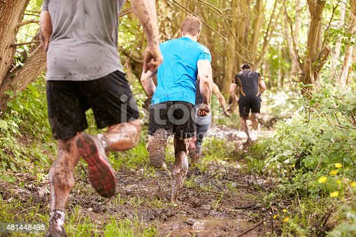 986840244 istock photo Competitors running in a forest at an endurance event 481448498