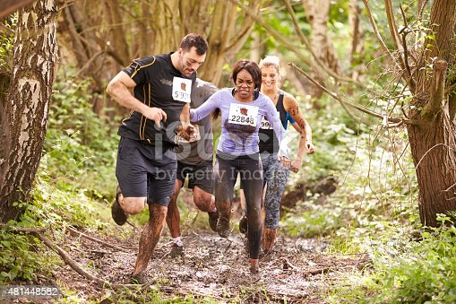 986840244 istock photo Competitors running in a forest at an endurance event 481448582