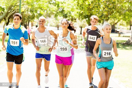 istock Competitors Running Marathon At Park 505232737