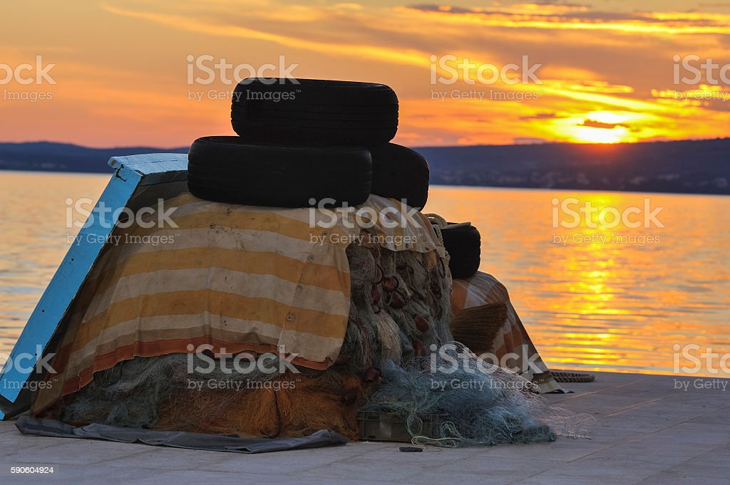 complains fishing nets at the pier with tires stock photo