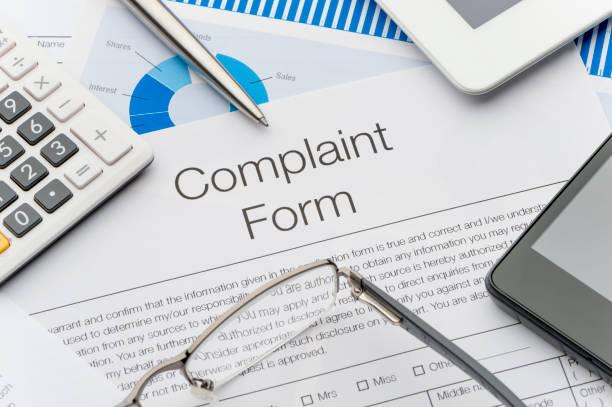 Complaint form on a desk. stock photo