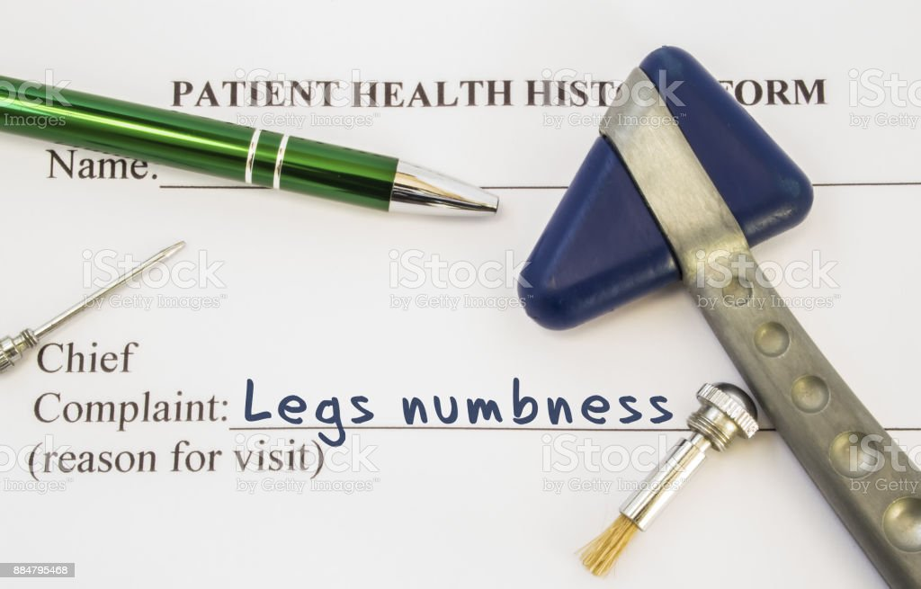 Complaint legs numbness. Patient health history is on table of neurologist, which contains complaint legs numbness surrounded by neurological hammer, brush and needle to determine sensitivity of skin stock photo