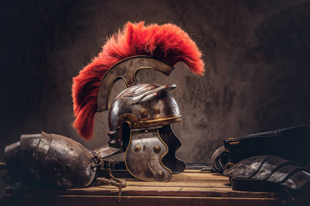 complete combat equipment of the ancient greek warrior lie on a box of wooden boards. - roman stock photos and pictures