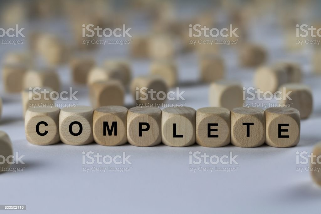 complete - cube with letters, sign with wooden cubes stock photo