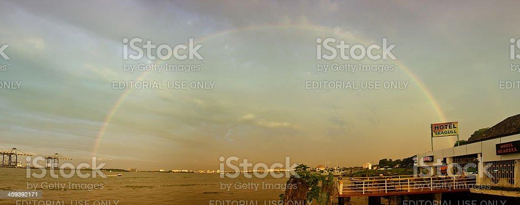 Complete rainbow over docks at Kochi City, India stock photo