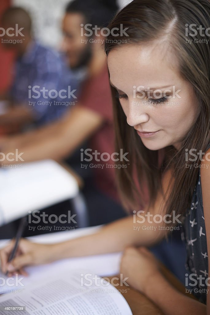 Completely absorbed in her work royalty-free stock photo