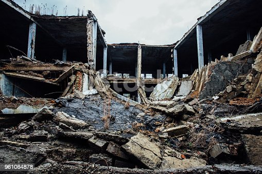 istock Completely destroyed by war collapsed industrial building 961064878