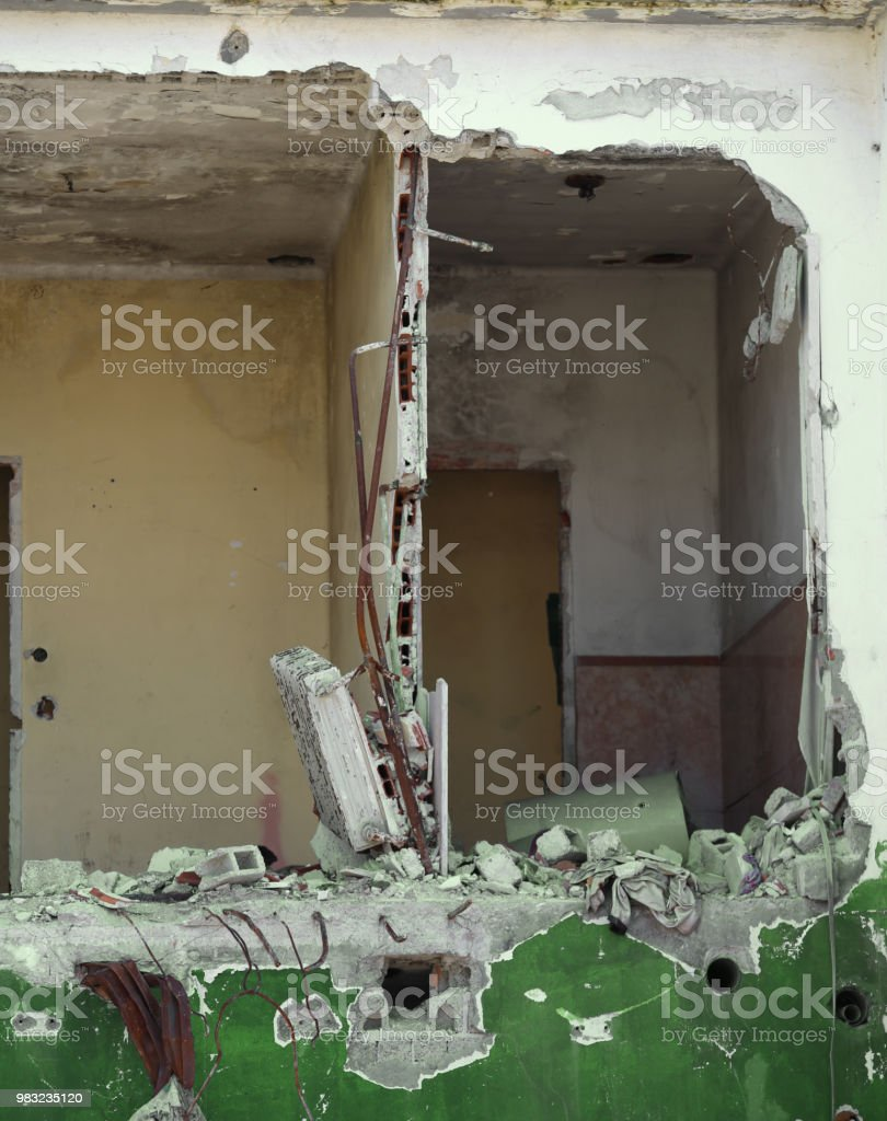 completely destroyed house with broken walls and without furniture