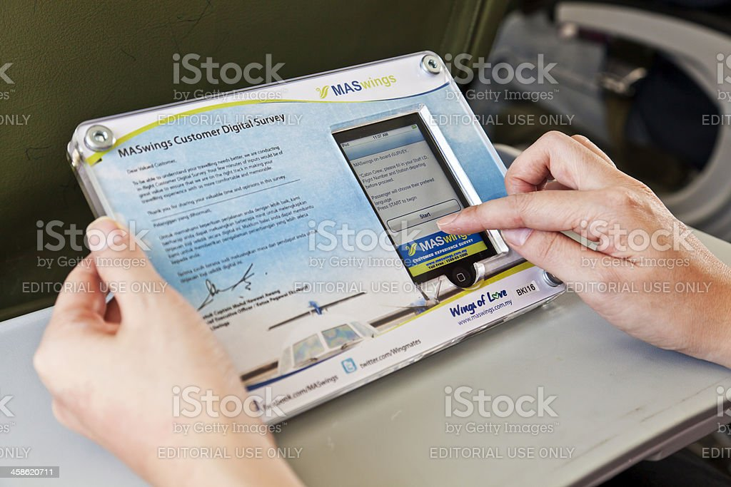 Completing a digital survey on an ipod royalty-free stock photo