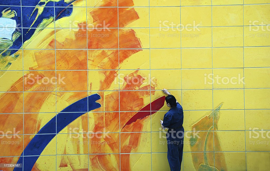 Completing a large painting stock photo