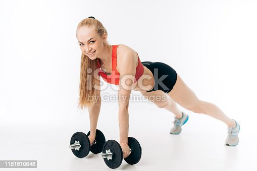 complex exercises with dumbbells. way to burn calories. movement with dumbbells. full length side view shot