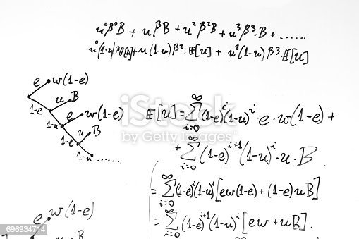istock Complex math formulas on whiteboard. Mathematics and science with economics 696934714