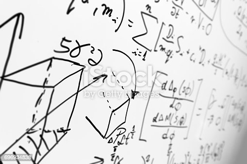 istock Complex math formulas on whiteboard. Mathematics and science with economics 696934838