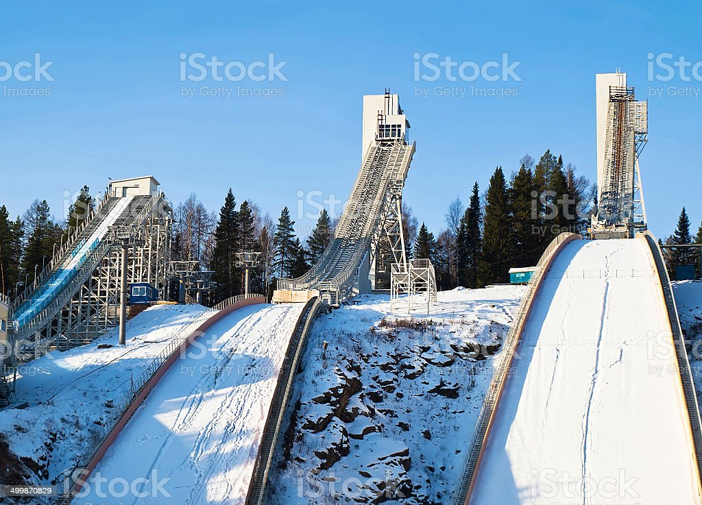 Complex of ski springboards against the blue sky stock photo